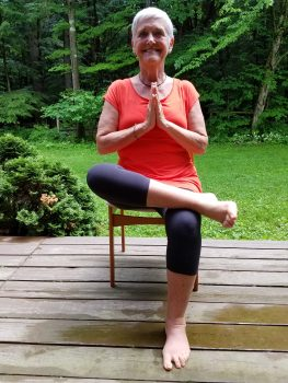 Dr. Carol Bokan, a senior and Kripula certified yoga teacher, models a Lakshmi Voelker chair yoga class pose